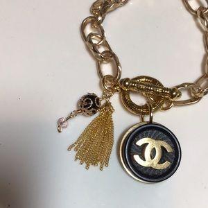 Black/gold Authentic Chanel Button bracelet.